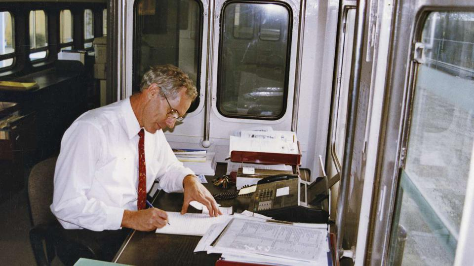 Tom Forgan in the new ATP train carriage office which he and his family refurbished, c. 1993