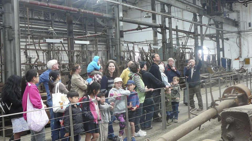 Volunteer and Eveleigh Blacksmith, Richard Butcher, delivers a heritage tour to visitors at ATP