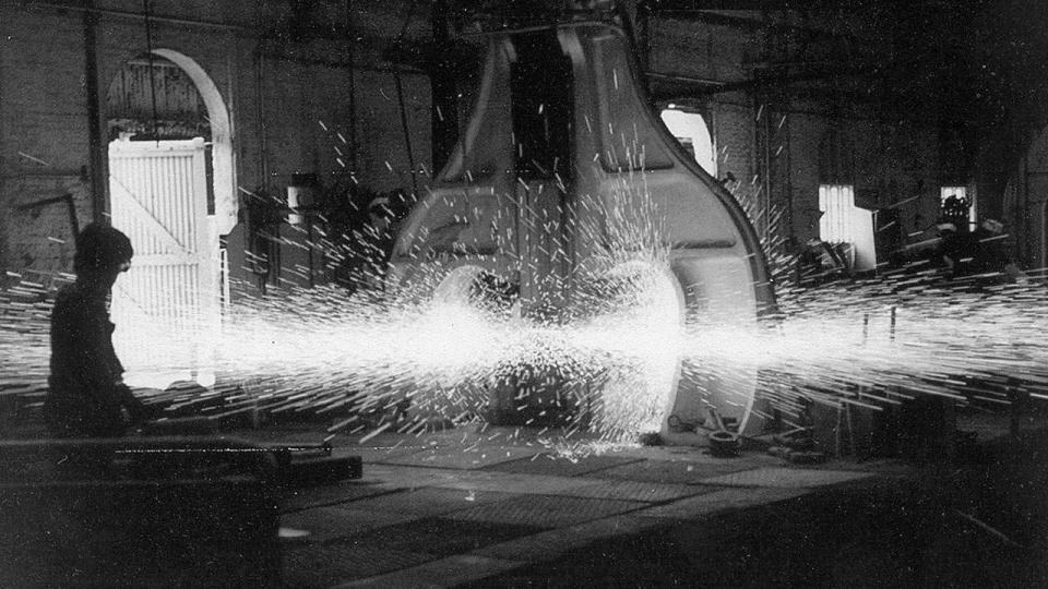 The double arch drop hammer was where the sparks flew and often spewed to the furthest doors 30 metres away. At times oil sprayed from the top and the bottom die blocks, and as the tup (hammer) rose a cloud similar to an atomic bomb rose skywards.