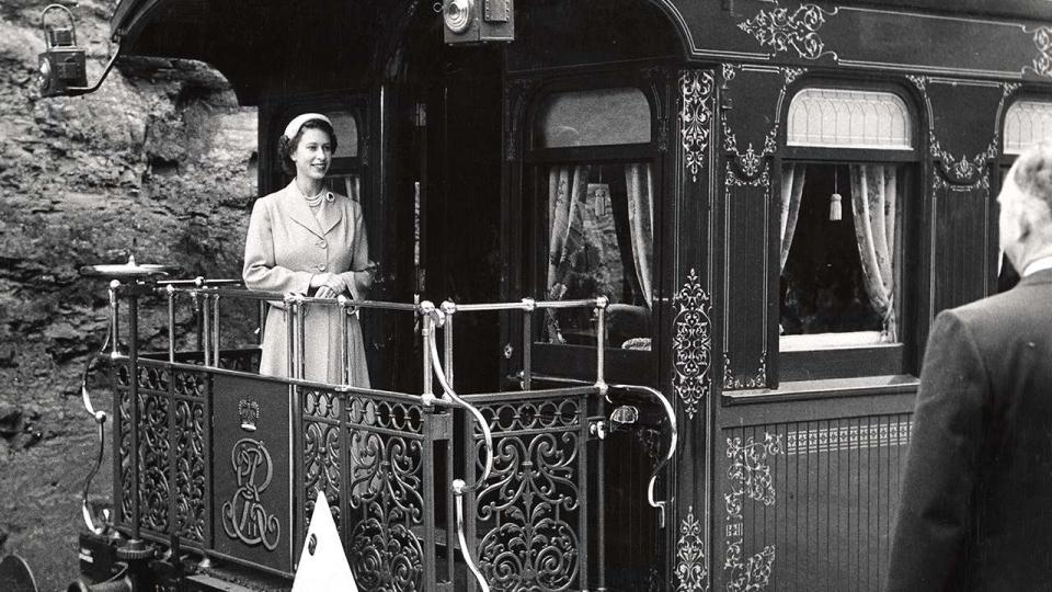 Queen Elizabeth II on board the Royal carriage, 1954