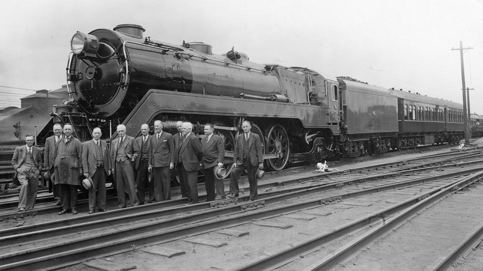 Handover of the new 38-class locomotive designed by the CME branch and built at Eveleigh. Chief Mechanical Engineer Mr Young is fourth from the left. 14 December 1945.