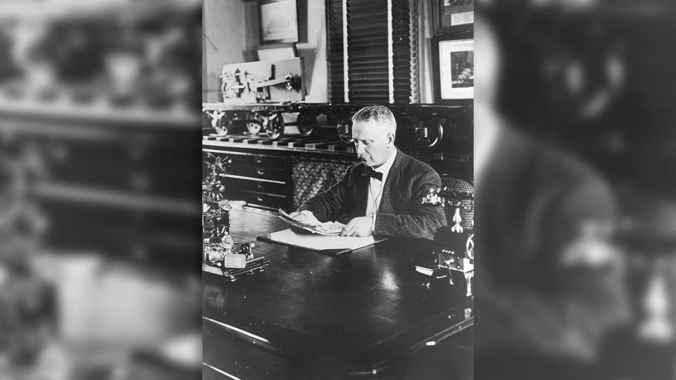 Mr Ernest Edward Lucy CME at his desk in room 18 oft the CME office in Wilson Street.