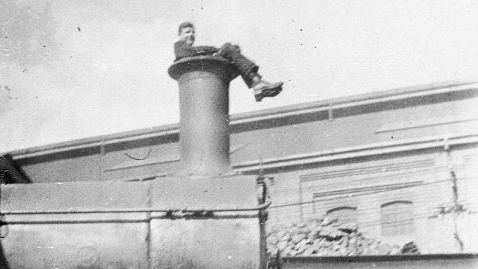 Sitting in the funnel of a steam locomotive, Eveleigh Railway Workshops during 1917 rail strike