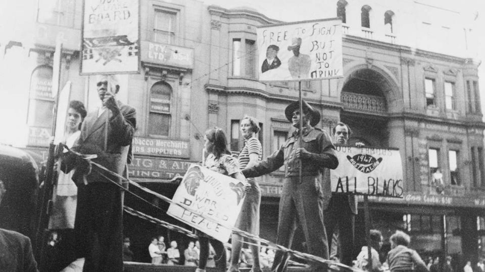 Herbert Groves, Aboriginal activist, spoke at Eveleigh during lunch meetings. His sign says 'Free to fight but not to drink'referring to discrimination against Aboriginal veterans who were not allowed into returned services venues, such as the RSL.