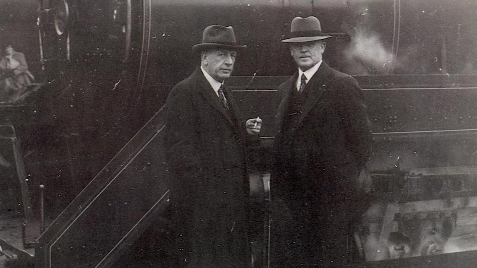 Mr Harold Young CME (left) at Sydney Terminal (now Central Station) with locomotive No.3822, one of 30 express passenger locomotives which he had designed. 30 April 1948.